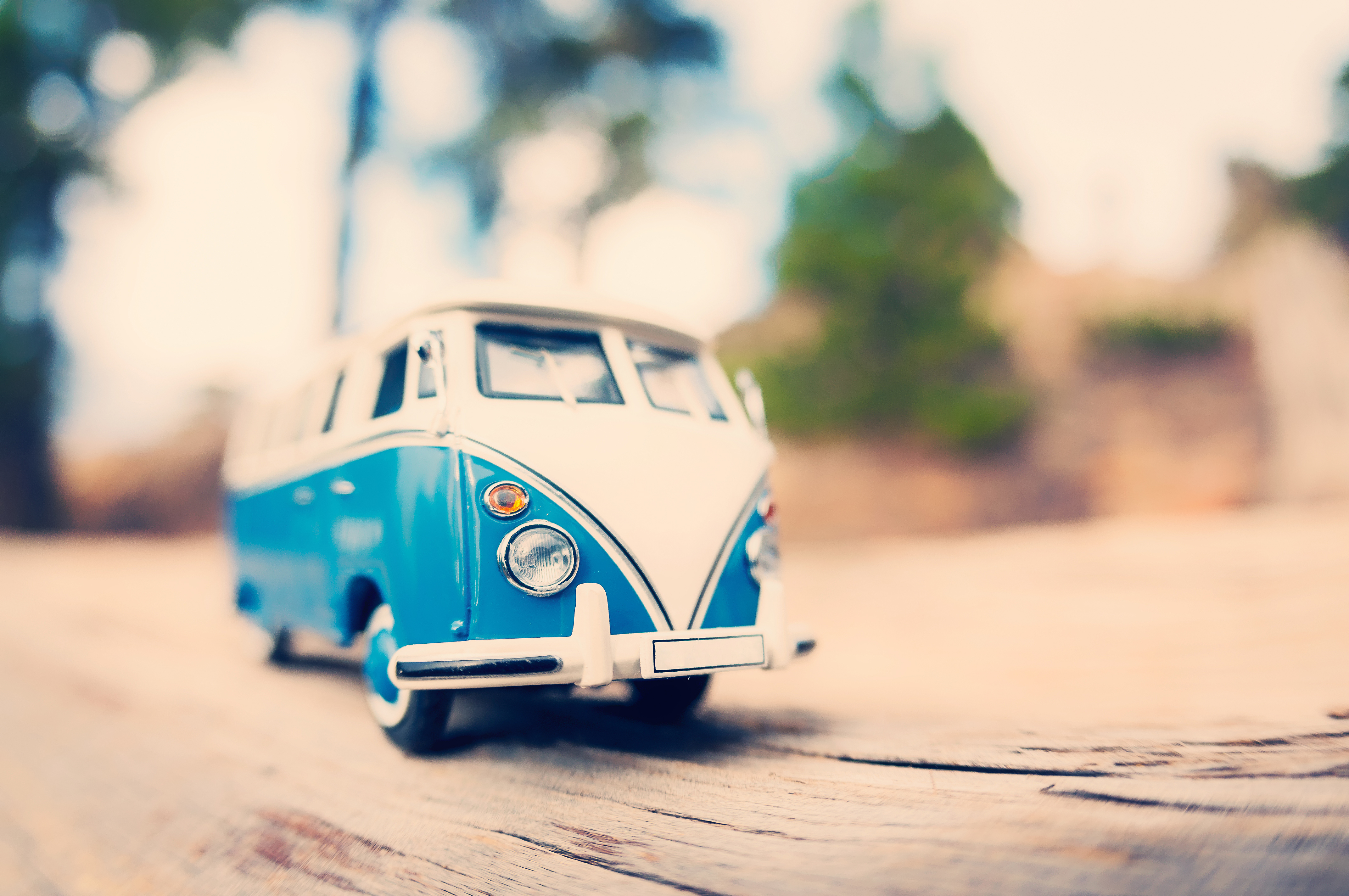 Miniature vintage van on a countryside road. Color tone tuned macro photo